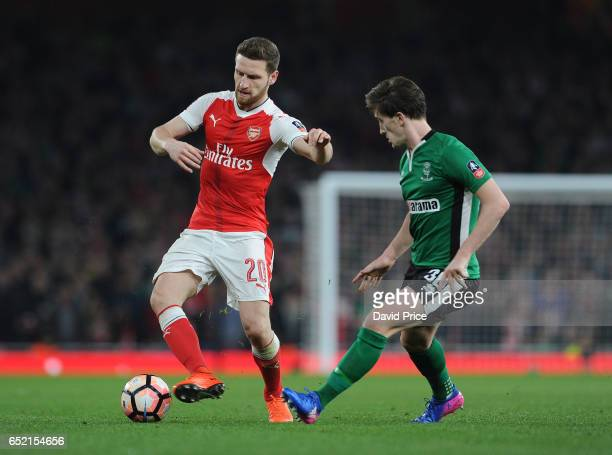Shkodran Mustafi of Arsenal takes on Alex Woodyard of Lincoln during the match between Arsenal and Lincoln City at Emirates Stadium on March 11 2017...