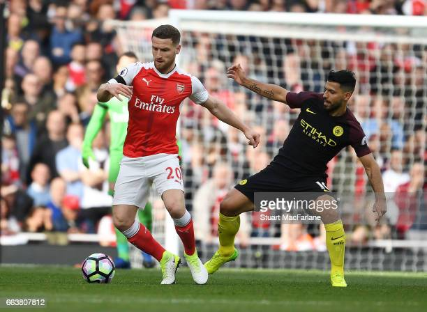 Shkodran Mustafi of Arsenal takes on Sergio Aguero of Man City during the Premier League match between Arsenal and Manchester City at Emirates...