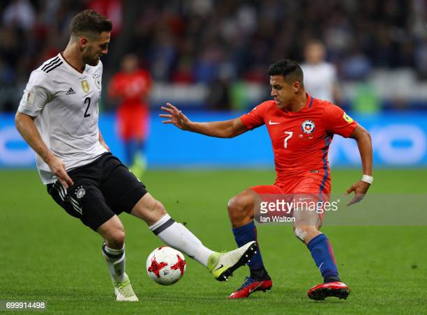 Shkodran Mustafi of Germany and Alexis Sanchez of Chile battle for possession during the FIFA Confederations Cup Russia 2017 Group B match between...