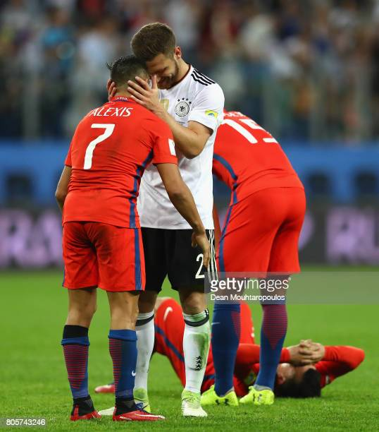 Shkodran Mustafi of Germany and Alexis Sanchez of Chile embrace after the FIFA Confederations Cup Russia 2017 Final between Chile and Germany at...