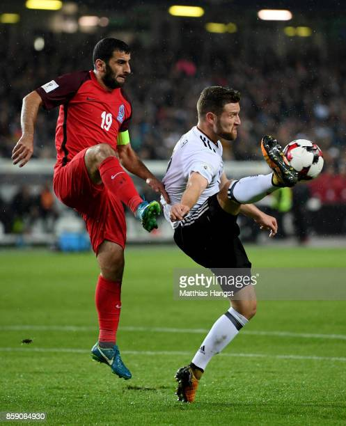Shkodran Mustafi of Germany and Rahid Amirguliyev of Azerbaijan battle for the ball during the FIFA 2018 World Cup Qualifier between Germany and...