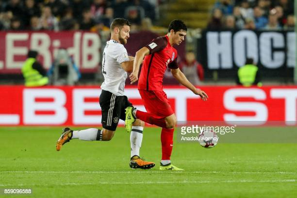 Shkodran Mustafi of Germany and Ruslan Gurbanov of Azerbaijan battle for the ball during the FIFA 2018 World Cup Qualifier between Germany and...