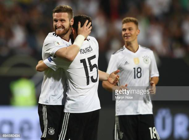 Shkodran Mustafi of Germany celebrates scoring his sides fifth goal with his Germany team mates during the FIFA 2018 World Cup Qualifier between...