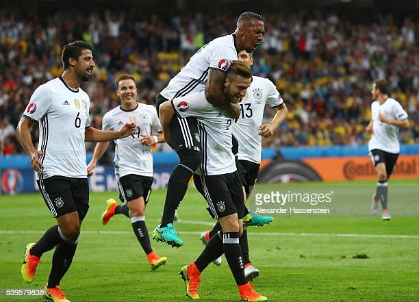 Shkodran Mustafi of Germany celebrates scoring his team's first goal with his team mates during the UEFA EURO 2016 Group C match between Germany and...