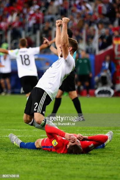Shkodran Mustafi of Germany celebrates victory at the final whistle during the FIFA Confederations Cup Russia 2017 Final match between Chile and...