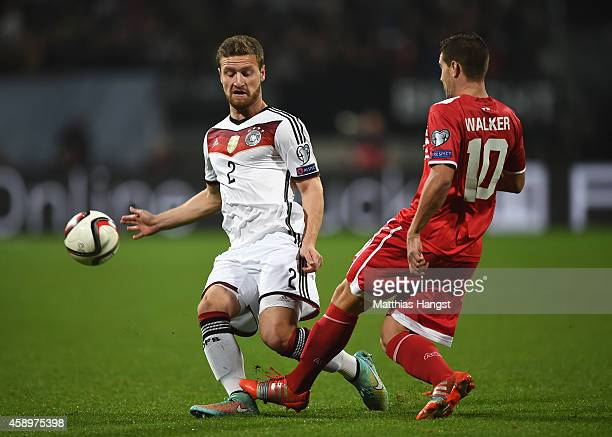 Shkodran Mustafi of Germany closes down Liam Walker of Gibraltar during the EURO 2016 Group D Qualifier match between Germany and Gibraltar at...