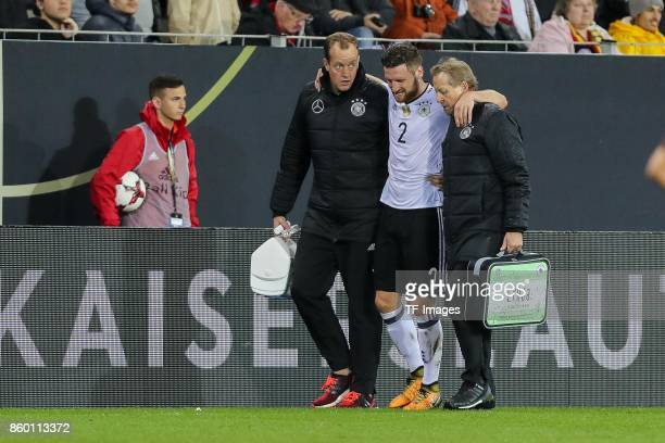 Shkodran Mustafi of Germany injured during the FIFA 2018 World Cup Qualifier between Germany and Azerbaijan at FritzWalter Stadium on October 8 2017...