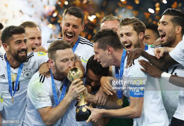 Shkodran Mustafi of Germany kisses the trophy after the FIFA Confederations Cup Russia 2017 Final between Chile and Germany at Saint Petersburg...