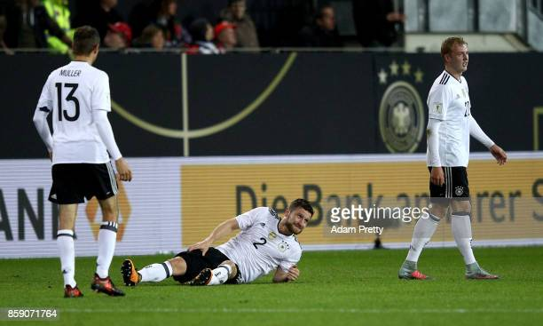 Shkodran Mustafi of Germany lies injured on the pitch during the FIFA 2018 World Cup Qualifier between Germany and Azerbaijan at FritzWalterStadion...