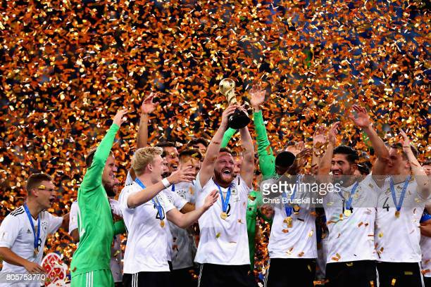 Shkodran Mustafi of Germany lifts the FIFA Confederations Cup trophy after the FIFA Confederations Cup Russia 2017 Final match between Chile and...