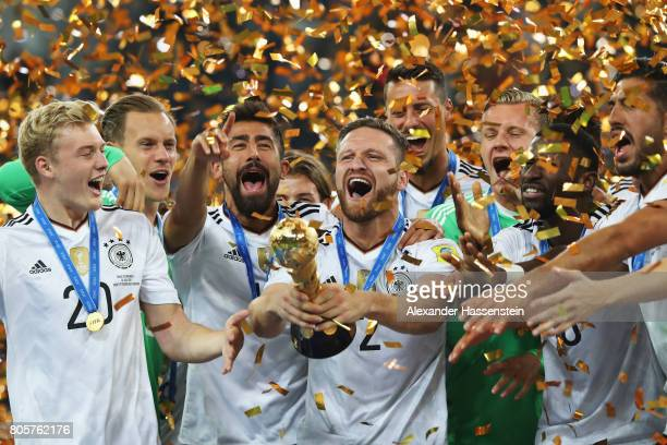 Shkodran Mustafi of Germany lifts the FIFA Confederations Cup trophy after the FIFA Confederations Cup Russia 2017 Final between Chile and Germany at...