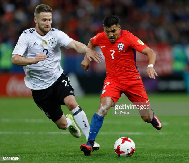 Shkodran Mustafi of Germany national team and Alexis Sanchez of Chile national team vie for the ball during the Group B FIFA Confederations Cup...