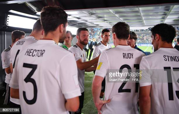 Shkodran Mustafi of Germany speaks to his team mates in the tunnel at half time during the FIFA Confederations Cup Russia 2017 Final between Chile...