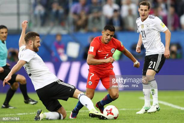 Shkodran Mustafi of Germany tackles Alexis Sanchez of Chile during the FIFA Confederations Cup Russia 2017 Final between Chile and Germany at Saint...