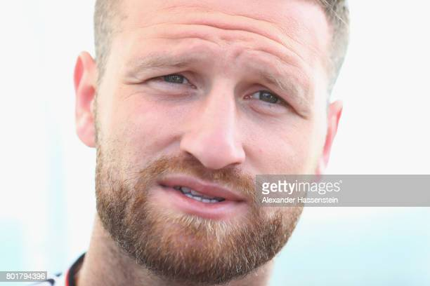 Shkodran Mustafi of Germany talks to the media during a mixed zone press conference prior to a team Germany training session at Park Arena training...
