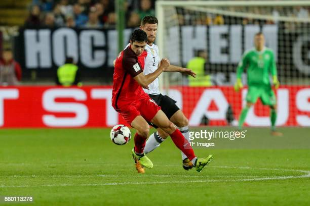 Shkodran Mustafi of Germany und Ruslan Gurbanov of Azerbaijan battle for the ball during the FIFA 2018 World Cup Qualifier between Germany and...