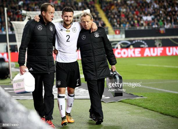 Shkodran Mustafi of Germany walks injured off the field during the FIFA 2018 World Cup Qualifier between Germany and Azerbaijan at FritzWalterStadion...