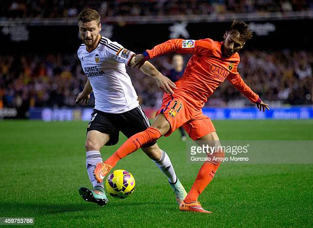 Shkodran Mustafi of Valencia CF competes for the ball with Neymar JR of FC Barcelona during the La Liga match between Valencia CF and FC Barcelona at...