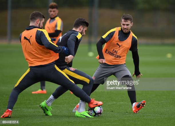 Shkodran Mustafi Olivier Giroud and Aaron Ramsey of Arsenal during a training session at London Colney on March 17 2017 in St Albans England