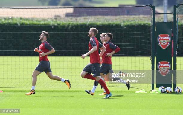 Shkodran Mustafi Per Mertesacker and Laurent Koscielny of Arsenal during a training session at London Colney on August 1 2017 in St Albans England