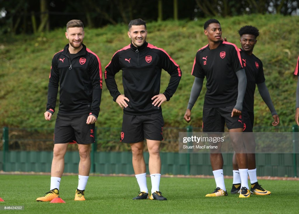Shkodran Mustafi, Sead Kolasinac and Jeff Reine-Adelaide of Arsenal during a training session at London Colney on September 13, 2017 in St Albans, England.