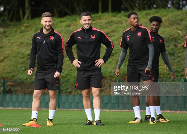 Shkodran Mustafi Sead Kolasinac and Jeff ReineAdelaide of Arsenal during a training session at London Colney on September 13 2017 in St Albans England