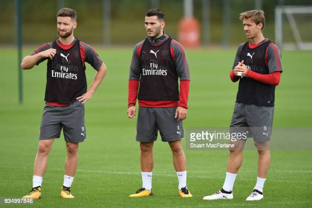 Shkodran Mustafi Sead Kolasinac and Nacho Monreal of Arsenal during a training session at London Colney on August 18 2017 in St Albans England
