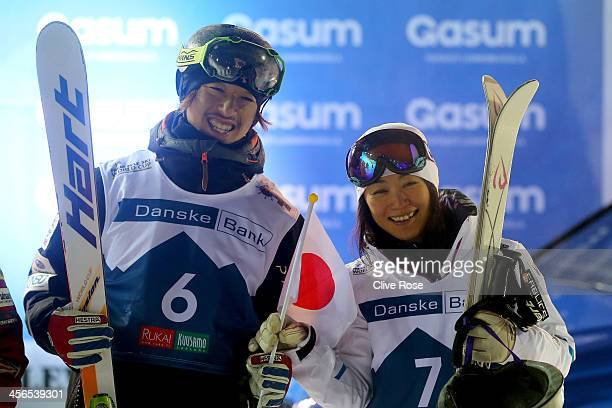 Sho Endo and Aiko Uemura of Japan pose together after both finishing in third position in the Men's and Ladies Moguls competition during the FIS...