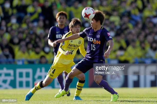 Sho Inagaki of Sanfrecce Hiroshima and Junya Ito of Kashiwa Reysol compete for the ball during the JLeague J1 match between Kashiwa Reysol and...