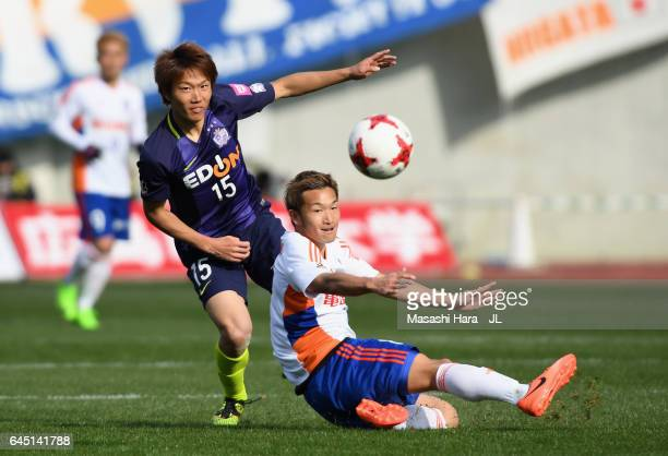 Sho Inagaki of Sanfrecce Hiroshima and Kei Koizumi of Albirex Niigata compete for the ball during the JLeague J1 match between Sanfrecce Hiroshima...