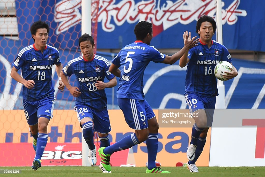 Sho Ito of Yokohama F.Marinos celebrates the 1st goal with Fabio of Yokohama F.Marinos during the J.League match between Nagoya Grampus and Yokohama F.Marinos at the Toyota Stadium on May 4, 2016 in Toyota, Aichi, Japan.