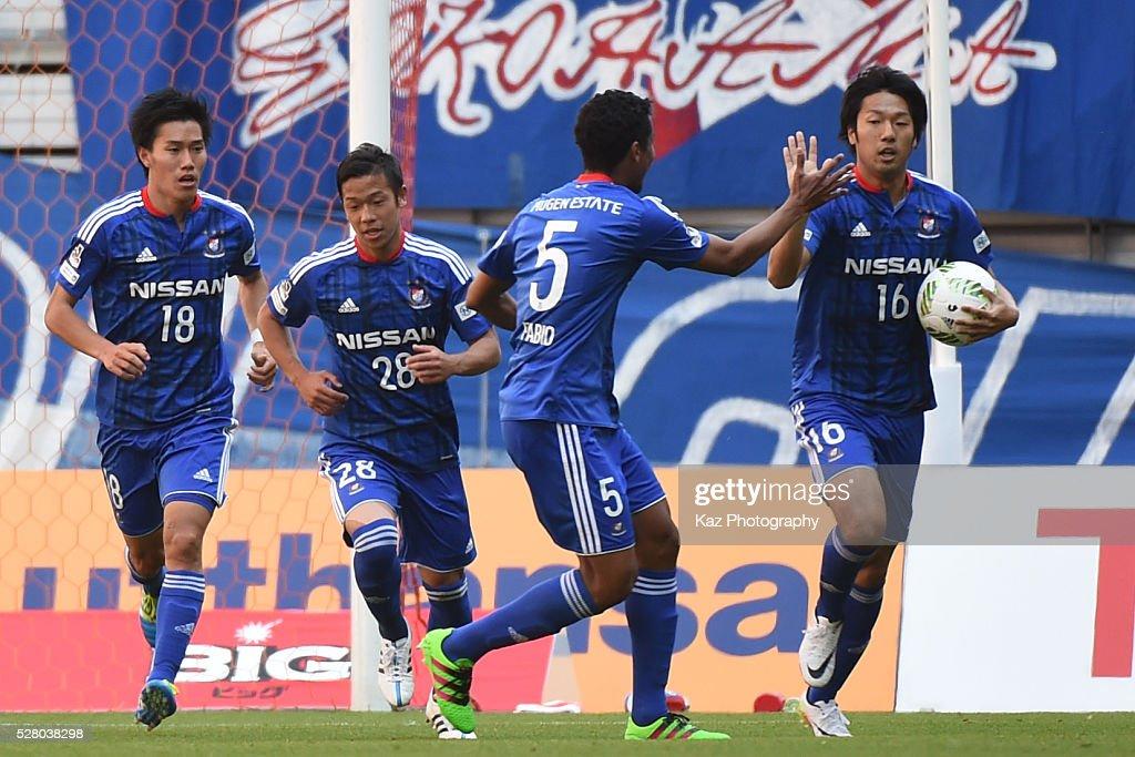 Sho Ito of Yokohama FMarinos celebrates the 1st goal with Fabio of Yokohama FMarinos during the JLeague match between Nagoya Grampus and Yokohama...