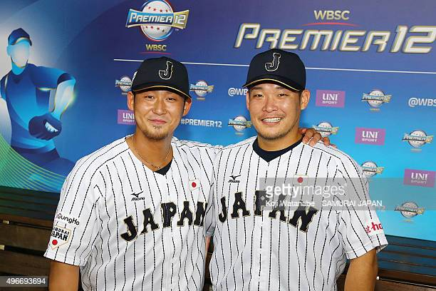 Sho Nakata and Yoshitomo Tsutsugo of Japan pose for photographs after their 65 win in the WBSC Premier 12 match between Mexico and Japan at the...