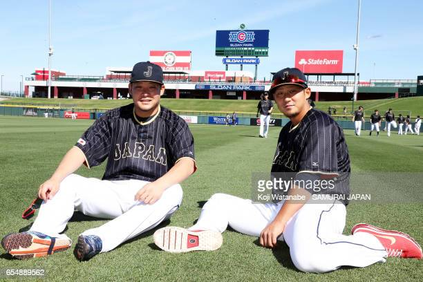 Sho Nakata and Yoshitomo Tsutsugoh of Japan looks on during the exhibition game between Japan and Chicago Cubs at Sloan Park on March 18 2017 in Mesa...