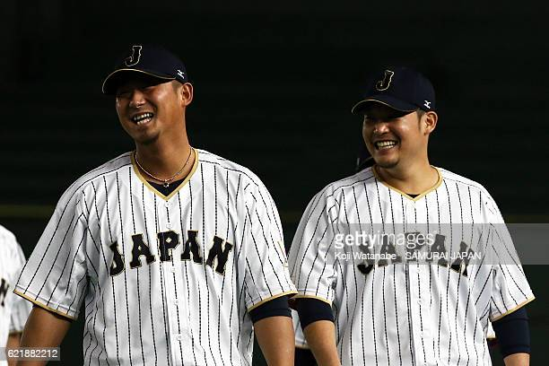 Sho Nakata and Yoshitomo Tsutsugoh of Samurai Japan looks on during the Japan national baseball team practice session at the Tokyo Dome on November 9...