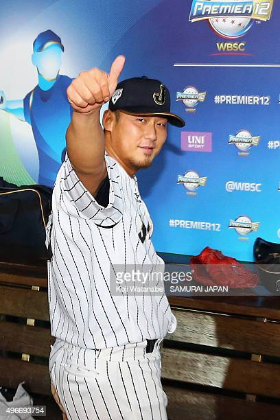 Sho Nakata of Japan celebrates after his team's 65 win in the WBSC Premier 12 match between Mexico and Japan at the Tianmu Baseball Stadium on...