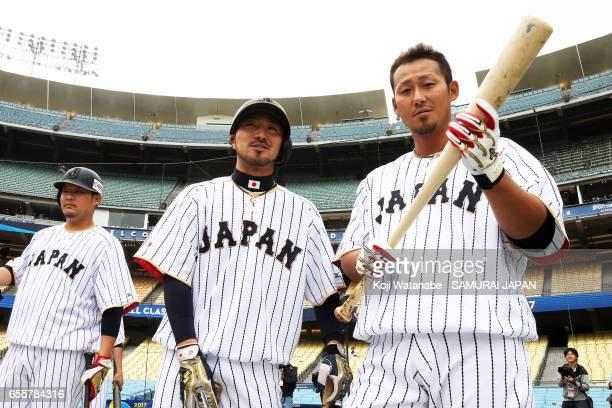 Sho Nakata and Ryosuke Kikuchi of Japan look on during a training session ahead of the World Baseball Classic Championship Round at Dodger Stadium on...