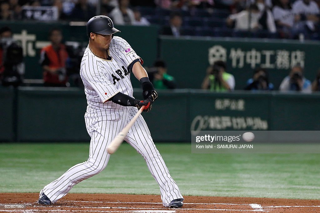 Sho Nakata #13 of Japan hits a RBI grounder in the first inning during the international friendly match between Japan and Netherlands at the Tokyo Dome on November 12, 2016 in Tokyo, Japan.