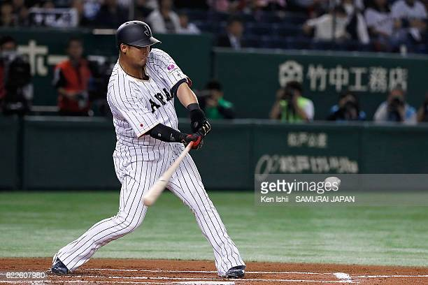 Sho Nakata of Japan hits a RBI grounder in the first inning during the international friendly match between Japan and Netherlands at the Tokyo Dome...