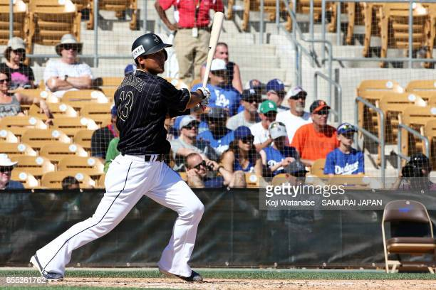 Sho Nakata of Japan hits a RBI single during in the bottom half of the fifth inningthe exhibition game between Japan and Los Angeles Dodgers at...