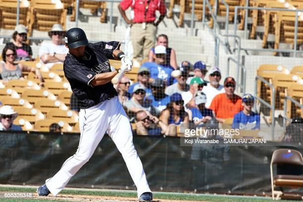 Sho Nakata of Japan hits a RBI single in the bottom half of the fifth inning during the exhibition game between Japan and Los Angeles Dodgers at...