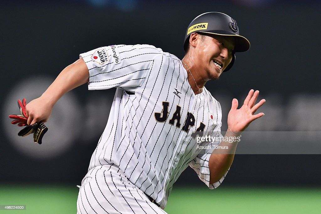 Sho Nakata #13 of Japan runs to score in the bottom of second inning during the WBSC Premier 12 match between Japan and South Korea at the Sapporo Dome on November 8, 2015 in Sapporo, Hokkaido, Japan.