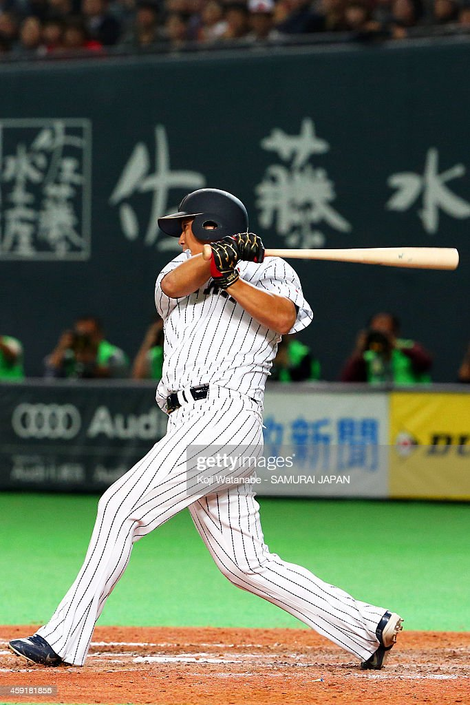 Sho Nakata #13 of Samurai Japan a sacrifice hit in the bottom half of the seventh inning during the game five of Samurai Japan and MLB All Stars at Sapporo Dome on November 18, 2014 in Sapporo, Hokkaido, Japan.