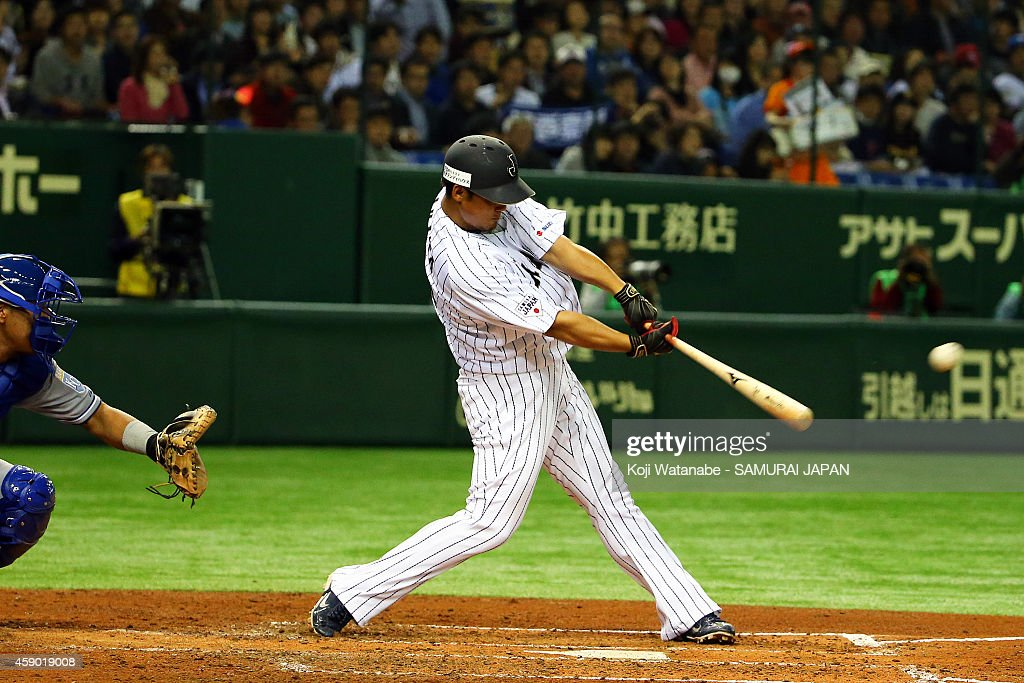 Sho Nakata #13 of Samurai Japan hits a two-run homer in the third inning during the game three of Samurai Japan and MLB All Stars at Tokyo Dome on November 15, 2014 in Tokyo, Japan.
