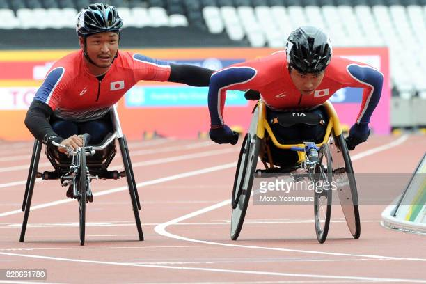 Sho Watanabe and Tomoki Suzuki of Japan compete in the Men's 4×400m Relay T53/54 exhibition raceduring day six of the IPC World ParaAthletics...