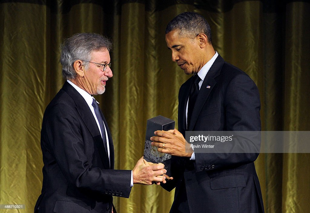 Shoah Foundation Honorary Chair <a gi-track='captionPersonalityLinkClicked' href=/galleries/search?phrase=Steven+Spielberg&family=editorial&specificpeople=202022 ng-click='$event.stopPropagation()'>Steven Spielberg</a> (L) presents the USC Shoah Foundation's Ambassadors for Humanity Award to U.S. President <a gi-track='captionPersonalityLinkClicked' href=/galleries/search?phrase=Barack+Obama&family=editorial&specificpeople=203260 ng-click='$event.stopPropagation()'>Barack Obama</a> onstage at USC Shoah Foundation's 20th Anniversary Gala at the Hyatt Regency Century Plaza on May 7, 2014 in Century City, California.