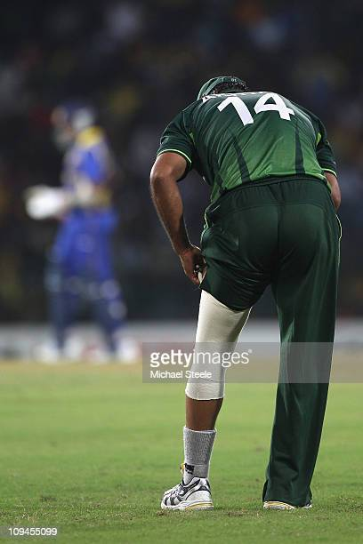 Shoaib Akhtar of Pakistan adjusts strapping on his leg during the Pakistan v Sri Lanka 2011 ICC World Cup Group A match at the R Premadasa Stadium on...