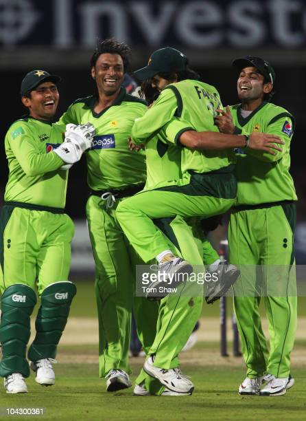 Shoaib Akhtar of Pakistan celebrates the wicket of Andrew Strauss of England with team mates during the 4th NatWest One Day International between...