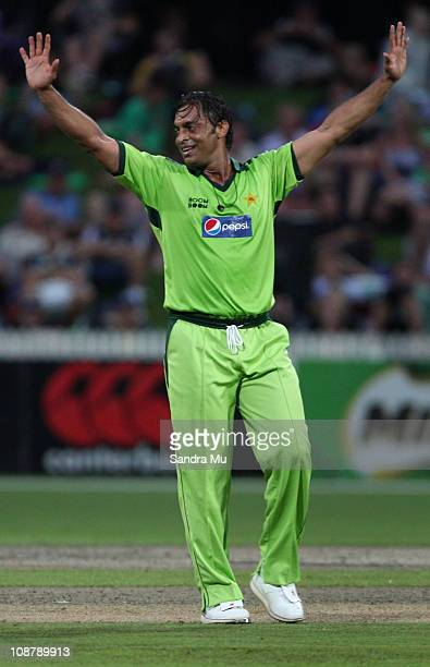 Shoaib Akhtar of Pakistan celebrates the wicket of Martin Guptill of the Black Caps during game five of the one day series between New Zealand and...