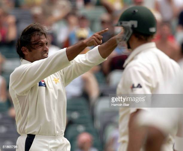 Shoaib Akhtar of Pakistan points Matthew Hayden of Australia to the dressing rooms after claiming his wicket during day one of the First Test between...